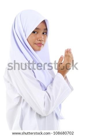 Southeast Asian youth Muslim prayer praying over white background - stock photo