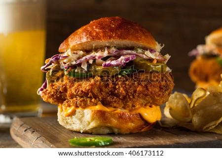 Southern Country Fried Chicken Sandwich with Mayo and Jalapenos - stock photo