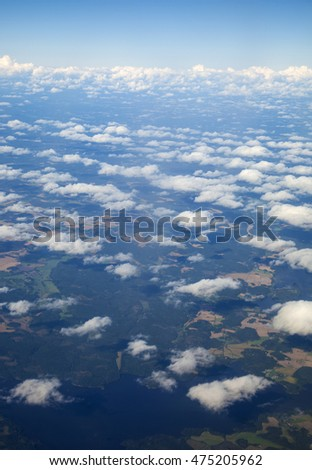 Southern Finland in late summer from airplane window