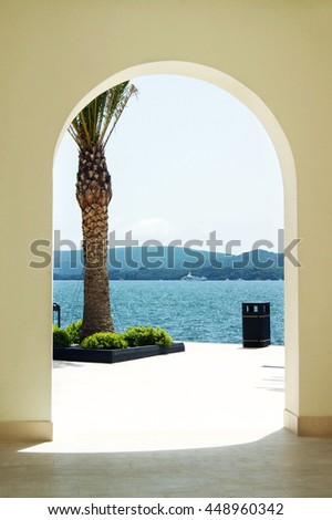 Southern landscape in the arched doorway - stock photo