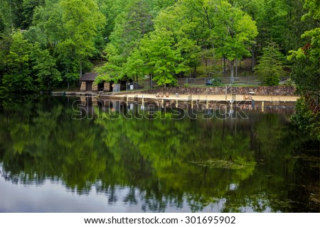 Southern Mountain Lake. Beach and boat docks in Pickett State Park in Jamestown, Tennessee. - stock photo