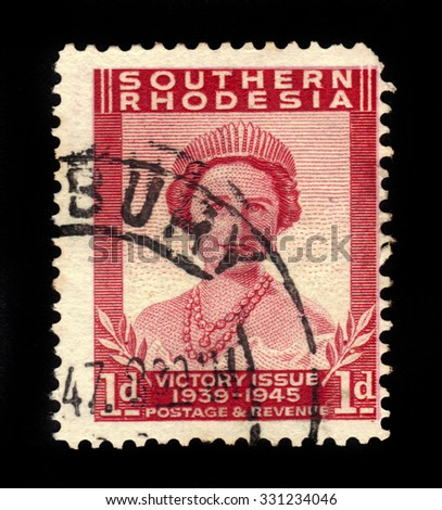 SOUTHERN RHODESIA - CIRCA 1946: A stamp printed in United Kingdom shows Queen Elizabeth The Queen Mother, Victory Peace issue, the end of World War II, circa 1946 - stock photo