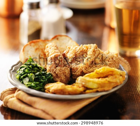 southern soul food with fried chicken and collard greens - stock photo