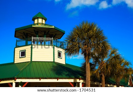 Southern style watch tower next to palm trees. - stock photo