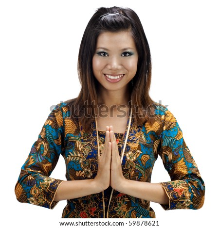 Southern Thai Muslim woman in a traditional welcoming gesture - stock photo