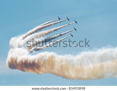 SOUTHPORT, ENGLAND - JULY 23: Hawk T Red Arrow jets from the British Air Force perform aerobatics and mid air stunts on  July 23, 2011 in Southport, England. - stock photo