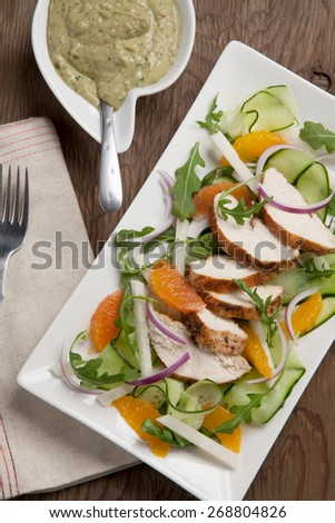 Southwest salad with sliced spiced-rubbed roasted turkey tenderloins with creamy avocado dressing.  - stock photo