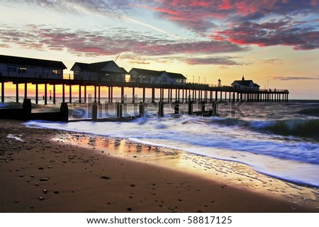 Southwold beach and pier at sunrise - stock photo