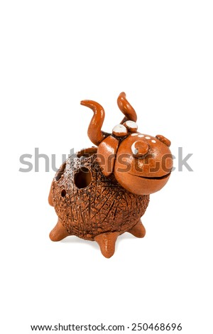 Souvenir ceramic comic cow with large horns isolated on a white background - stock photo