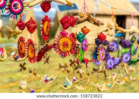 Souvenir from reed on Floating islands Titicaca lake, Peru,South America. - stock photo