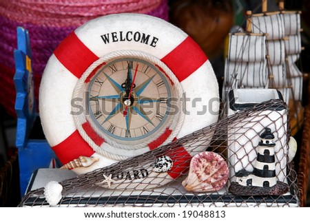 Souvenir hours with sea attributes - stock photo