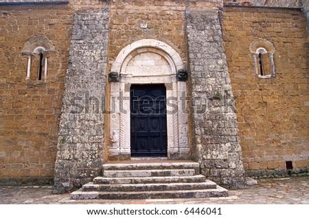 Sovana (Grosseto, Tuscany) - A portal of the ancient church - stock photo