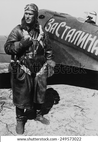 Soviet Ace pilot Boris Safonov, next to his I-16 airplane. Words on the aircraft read 'For Stalin'. 1941 photo by Evgenii Khaldei. - stock photo