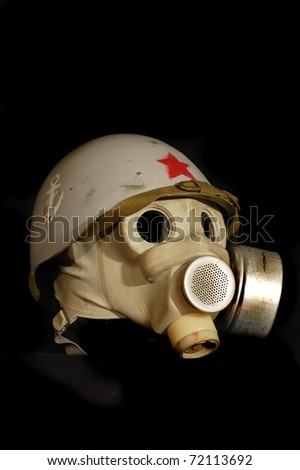 Soviet battle helmet. (M40)(1940) Painted for Marine Corp and gas mask - stock photo
