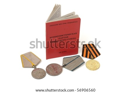 Soviet communist party membership card surrounded by old medals isolated - stock photo