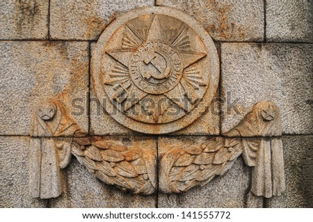 Soviet Emblem at Treptower Park. The Soviet War Memorial commemorates the Battle of Berlin in 1945 where 80,000 soldiers died. It opened at 1949 in Treptower Park, Berlin, Germany. - stock photo