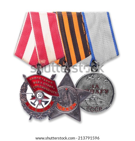 Soviet military Order of the Red Banner, Glory, Medal For Courage. It is isolated, the worker of paths is present. - stock photo