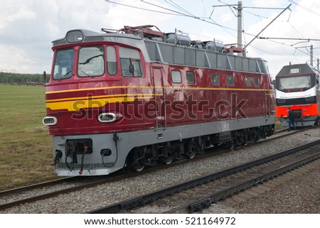 Soviet retro electric locomotive travels in the field