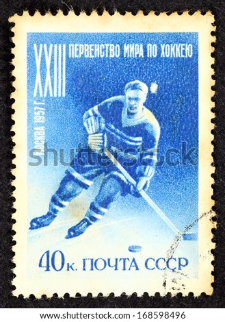 SOVIET UNION - CIRCA 1957: Blue color stamp printed in Soviet Union with image of an ice hockey player to commemorate the 23rd Men's Ice Hockey World Championships in Moscow, circa 1957. - stock photo