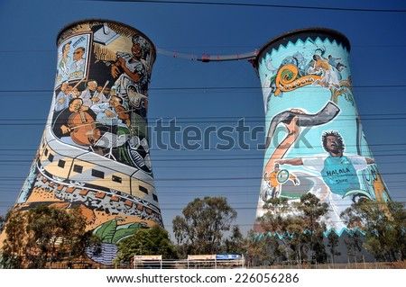 SOWETO, SOUTH AFRICA - SEPTEMBER 26 : Painted chimney pair at 26, September, 2014 at Soweto, South Africa. The painted chimney is the world famous landmark of Soweto, the slum of Johannesburg.
