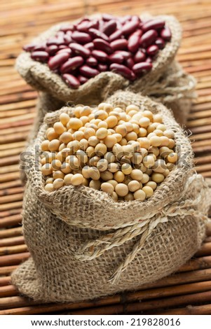 Soy beans and Red beans in hessian bags - stock photo