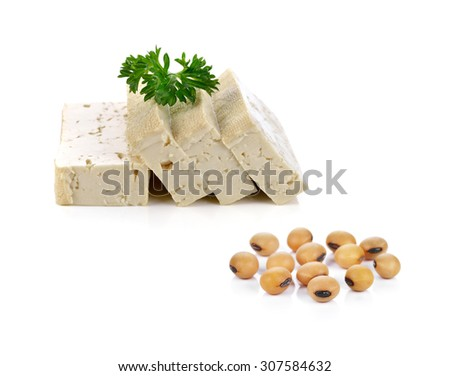 soy beans and tofu cheese on white background. - stock photo