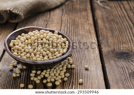 Soy Beans (detailed close-up shot) on rustic wooden background - stock photo