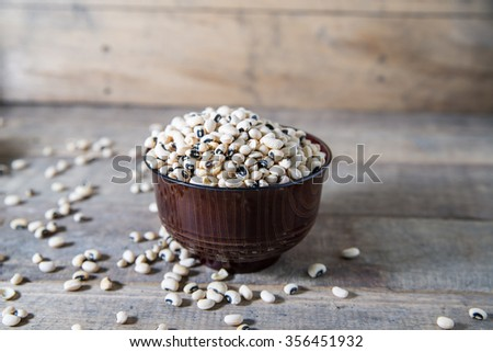 Soy Beans in wooden bowl - stock photo
