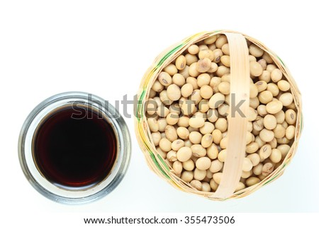 soy beans with soy sauce on white background - stock photo