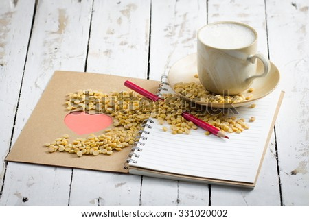 Soy Milk  Pencil and Book on White Wooden