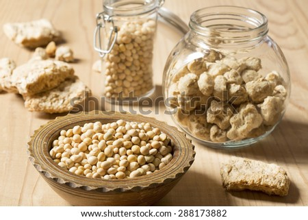 Soy protein and beans on a wooden background - stock photo