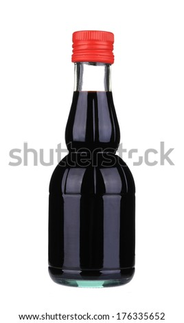 Soy sauce in a glass jar. Isolated on a white background. - stock photo