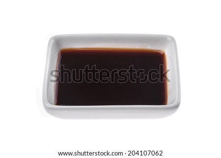 Soy sauce in a square bowl isolated on white