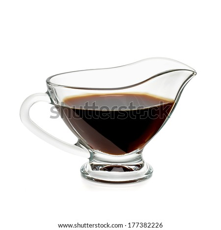 Soy sauce in gravy boat including clipping path - stock photo