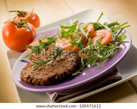 soy steak with arugula and tomatoes salad - stock photo