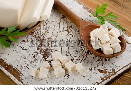 Soy Tofu on a wooden board. Selective focus - stock photo