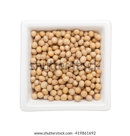 Soya beans in a square bowl isolated on white background