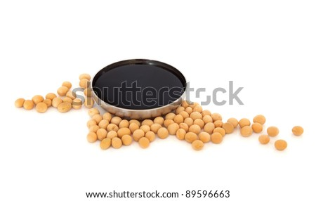 Soya beans with dark soy sauce in a stainless steel bowl isolated over white background. - stock photo