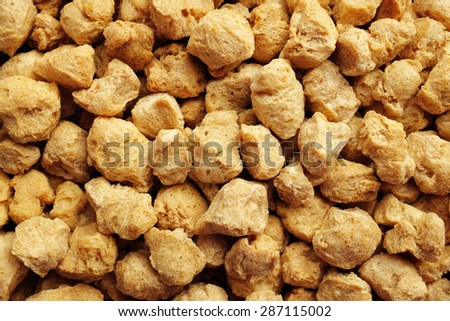 Soya protein chunks used in vegetarian and vegan food as an abstract background texture - stock photo