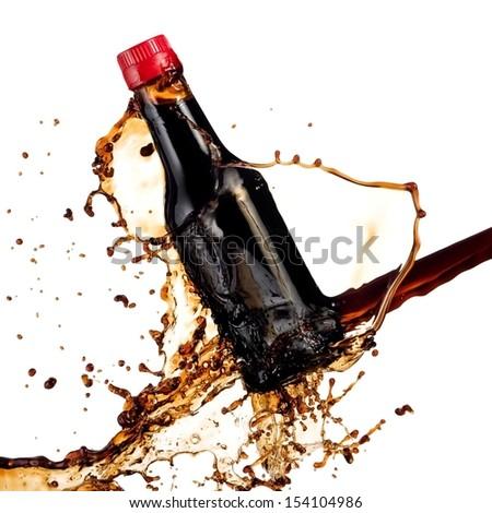 Soya sauce bottle splash with drops - stock photo