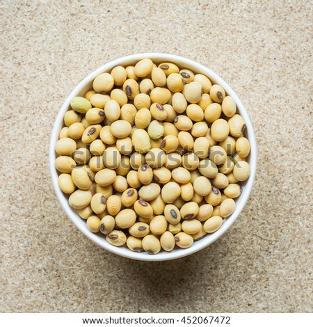 Soybean, Colorful various beans or lentils and whole grains seeds or cereal in white cup on wood background. - stock photo