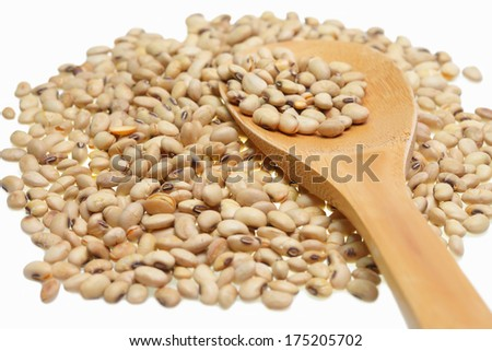 Soybean on wooden spoonl isolated on a white background.