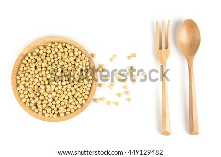 Soybeans in a wooden plate on a white background. - stock photo