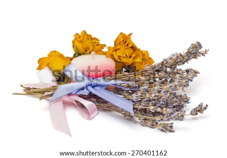 Spa Accessories, two bunches of lavender with ribbon, dried roses and a candle isolated on white - stock photo