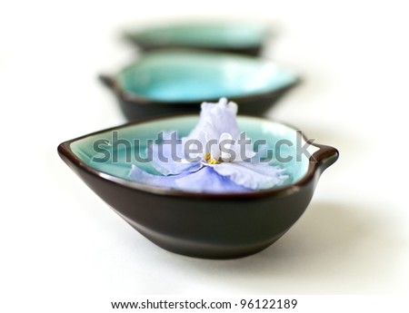 Spa accessories with violet flower - stock photo