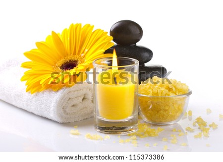 spa accessories, yellow flower and candles on white background - stock photo