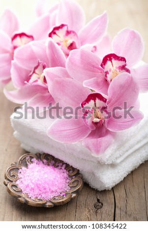 spa and bath with orchids - stock photo