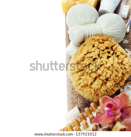 Spa and Wellness- bath brush, sponge, soap, towels and Herbal massage balls over white - stock photo