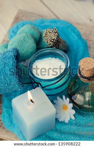 Spa and wellness setting with candles and towel. Blue dayspa nature set - stock photo