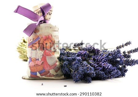 Spa and wellness setting with lavender flowers and spice bag - stock photo